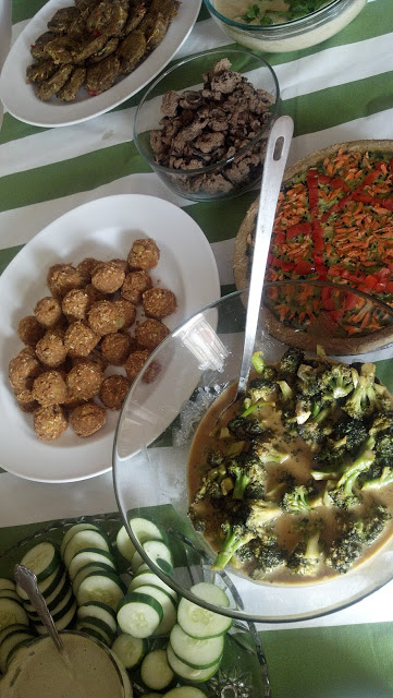 "Cucumber Slices with RAW vegan ranch, Sweet and Spicy Broccoli Salad, Carrot ""Sweet Potato Pie"" bites, etc.."