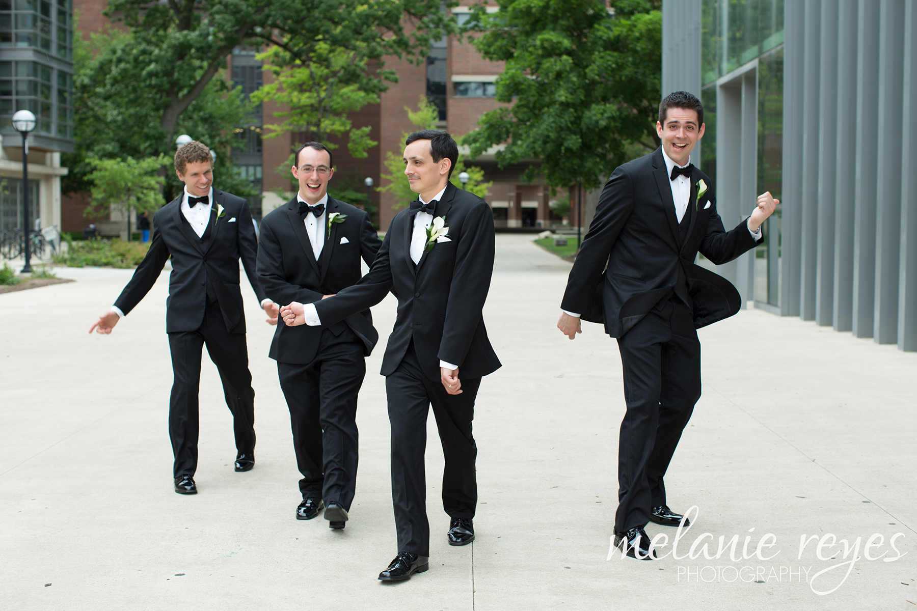 Groomsmen dance outside UofM Museum of Art