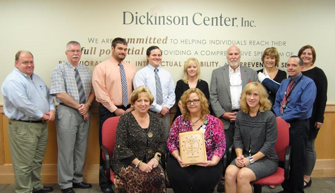 Back Row:   Jim Dixon, DCI Board Member; Dennis Crotzer, DCI Board Member; Joe Haines, DCI Board Member; Mike Fernan, DCI; Denise Geyer, DCI; Bill Conrad, DCI Board Member; Irene Davido, DCI;  Jim Prosper, DCI; Abbi Peters, DCI Board Member   Front Row:   Fran Kuhns, DCI Board Chair; Laura Sypien, Sis Simons Award Recipient; Heidi Thomas, DCI Interim Chief Executive Officer