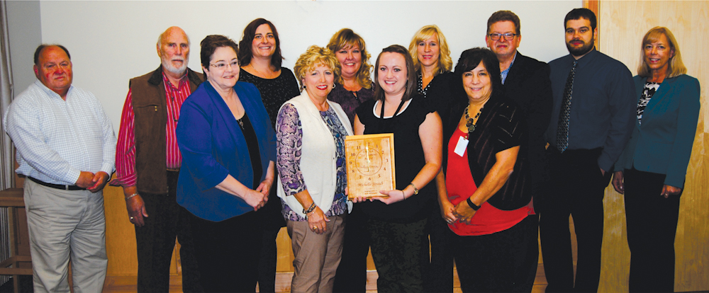 "Michelle Straub accepts the Elizabeth ""Sis"" Simons Memorial Award amongst Dickinson Center employees and board members"