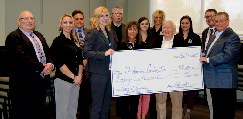 Photo of DCI Leadership and Signs of Suicide staff receiving a check for $86,000 from AJ & Sigismunda Palumbo Charitable Trust members.