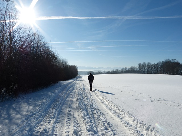 Man taking a walk in the snow