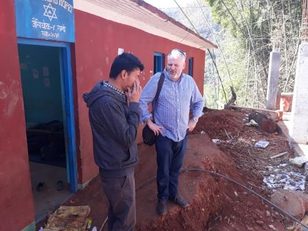 Dr. Craig Hutton and Tribhuvan University student, Amrit in discussion at one of the schools that is being rebuilt. (March 2018)
