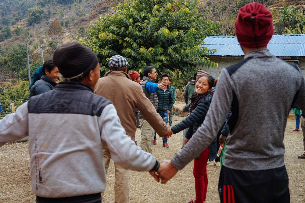 Workshops in Nepal are not all lectures and note taking. Togetherness is a key value in successful co-operatives. Narayan Dhakal leads an exercise outside to break up the day.