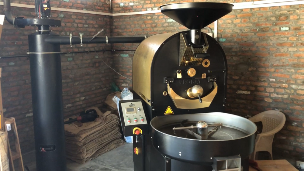 Nuwa Coffee Estate roast Nepal Glacier Coffee in their state of the art roasting machine, ready to be purchased by TGT to bring back to the UK.