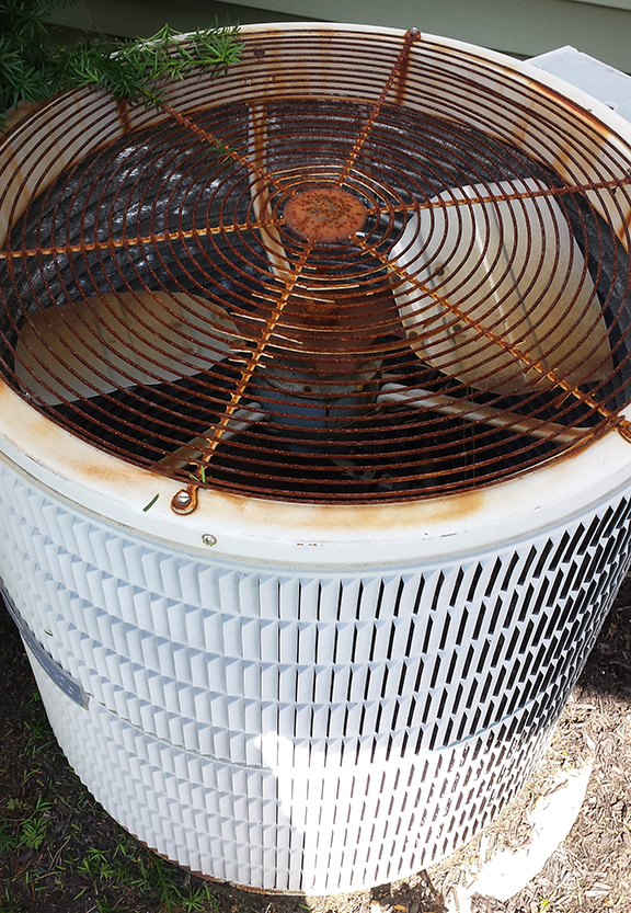 An A/C unit HovCov  ™ with excessive rusting
