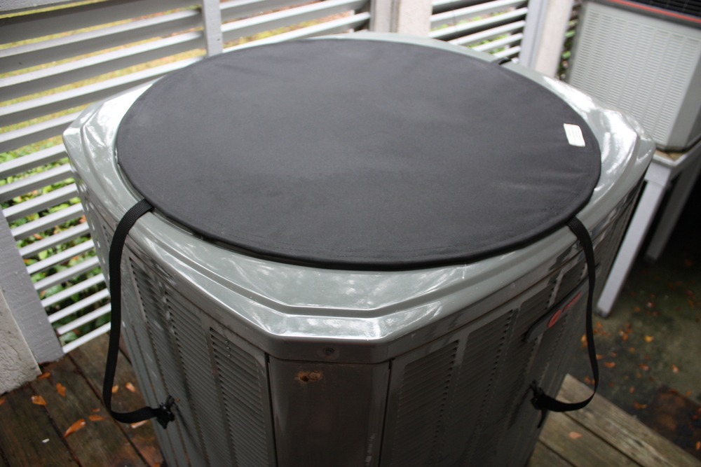 When the air conditioner or heat pump is off, the HovCov  ™ cover rests on top of the unit protecting it from rain and debris