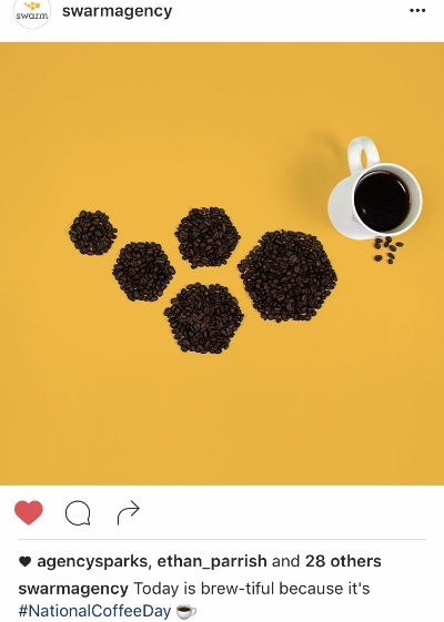 Swarm Agency honoring #NationalCoffeeDay by arranging coffee beans to mirror the design of their logo.