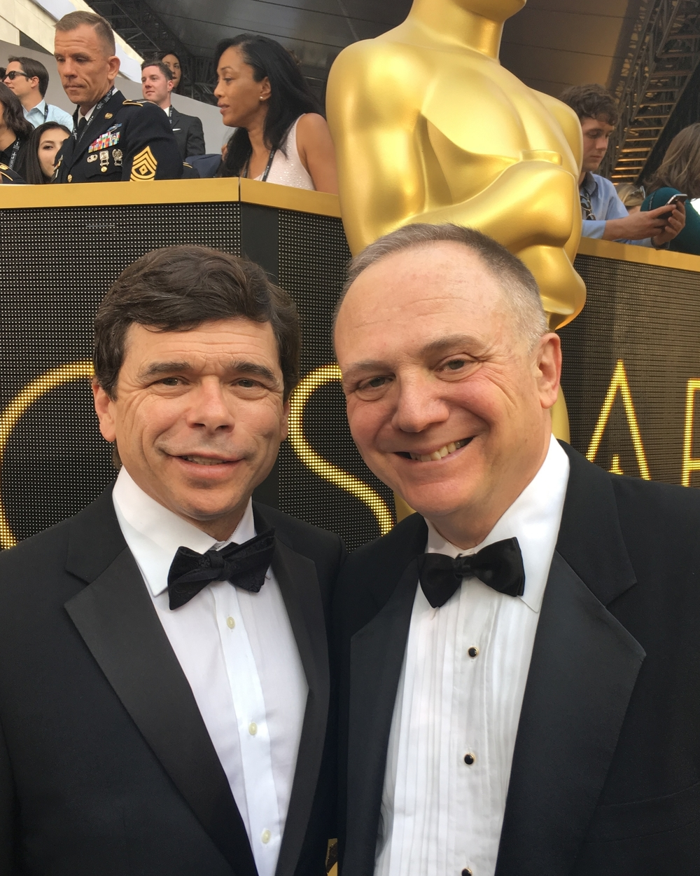 Investigative reporter Mike Rezendes (L) and UGFTV Chair Joe Pichirallo (R) at the 88th Academy Awards.  Rezendes is portrayed by Mark Ruffalo in the Best Picture and Best Original Screenplay winner  Spotlight,  directed by Tom McCarthy.  Rezendes and Pichirallo previously worked together as reporters at The Washington Post.