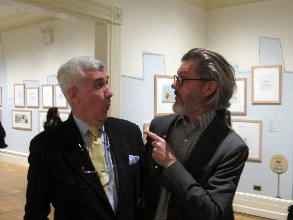 "Professor John Canemaker(L) jokingly reminisces with alum Mo Willems (UGFTV Animation, 1990) at the March 17, 2016 opening of ""The Art and Whimsy of Mo Willems"" at the New York Historical Society. Willems, renowned author-illustrator of beloved children's books (Knuffle Bunny and Don't Let the Pigeon Drive the Bus, among many others) includes in his mid-career exhibition drawings from his earliest animated films made at NYU. For more information on the exhibition and Mo Willems, visit: http://www.nytimes.com/2016/03/18/arts/design/mo-willems-and-the-art-of-the-childrens-book.html"