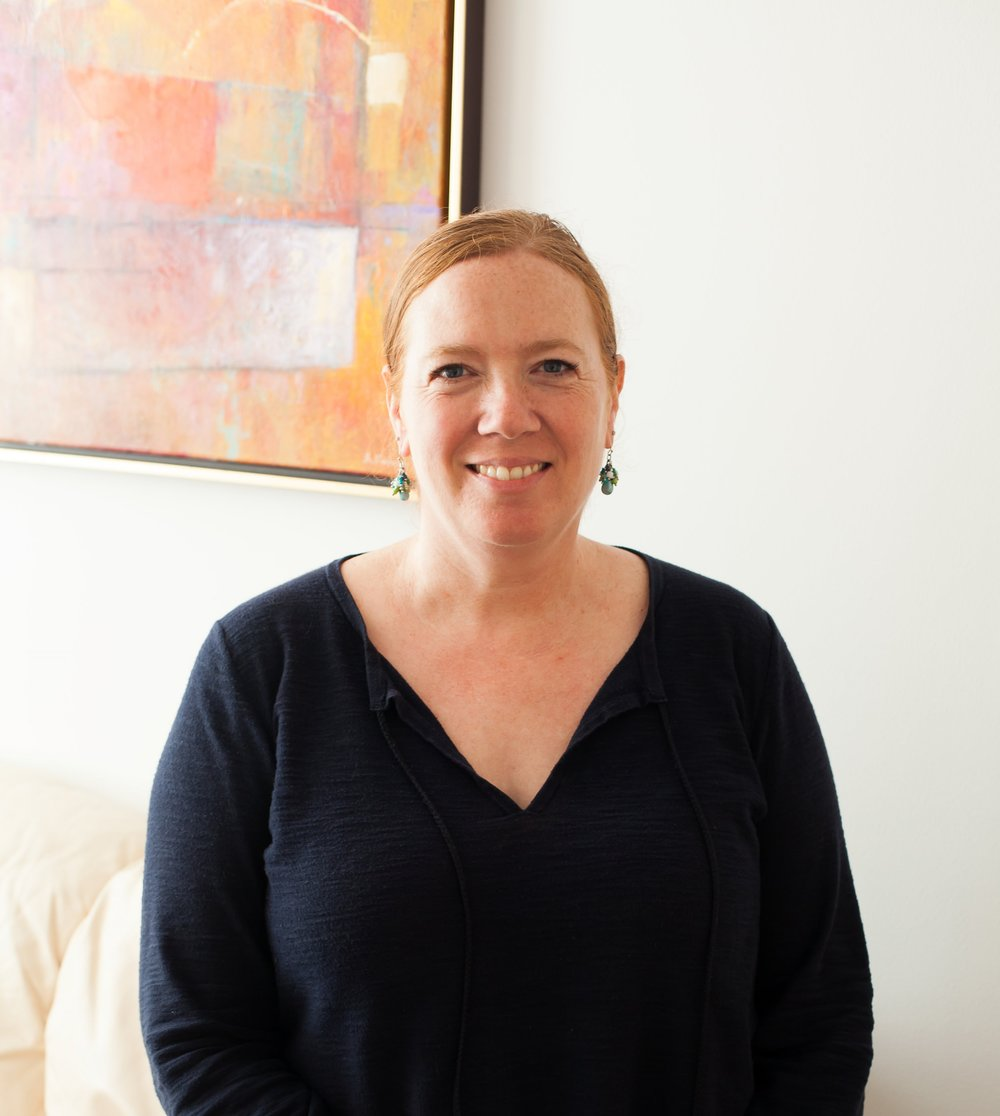 Integrative Trauma Therapist Laura Reagan, LCSW-C, CDWF, a clinical social worker specializing in trauma, attachment, LGBTQ issues, mindfulness and self compassion in Severna Park, Maryland.