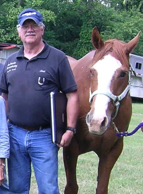 "Pictured here with  NEHRF  horse, ""Trace"""