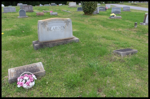 Pictured here is PFC Beardens grave plot before his stone arrived. Notice his family have theirs, but his is left empty.