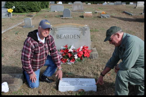 Here two Veterans help with placing the Memorial Marker. Finally, Beardens resting place is complete.
