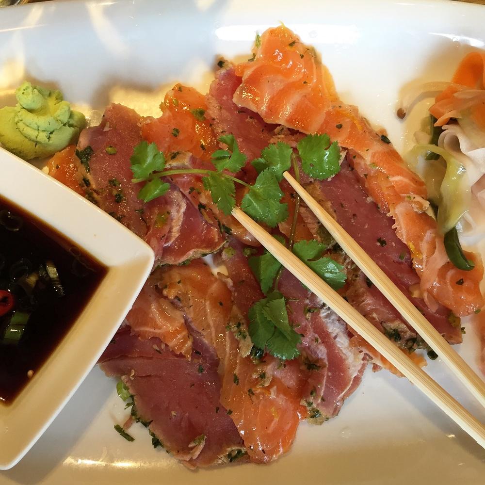 Tuna and salmon sashimi and pickle salad