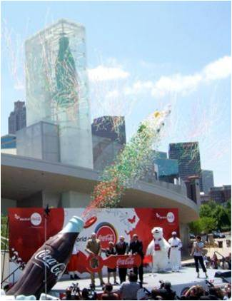 Coca Cola New World of COke Bottle and Stage View.jpg