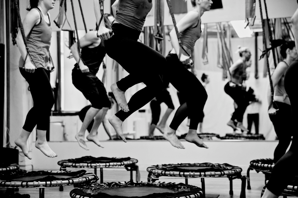 """""""Jumping on a trampoline is totally a workout, and you'll do that — plus resistant band exercises."""" - Refinery 29"""