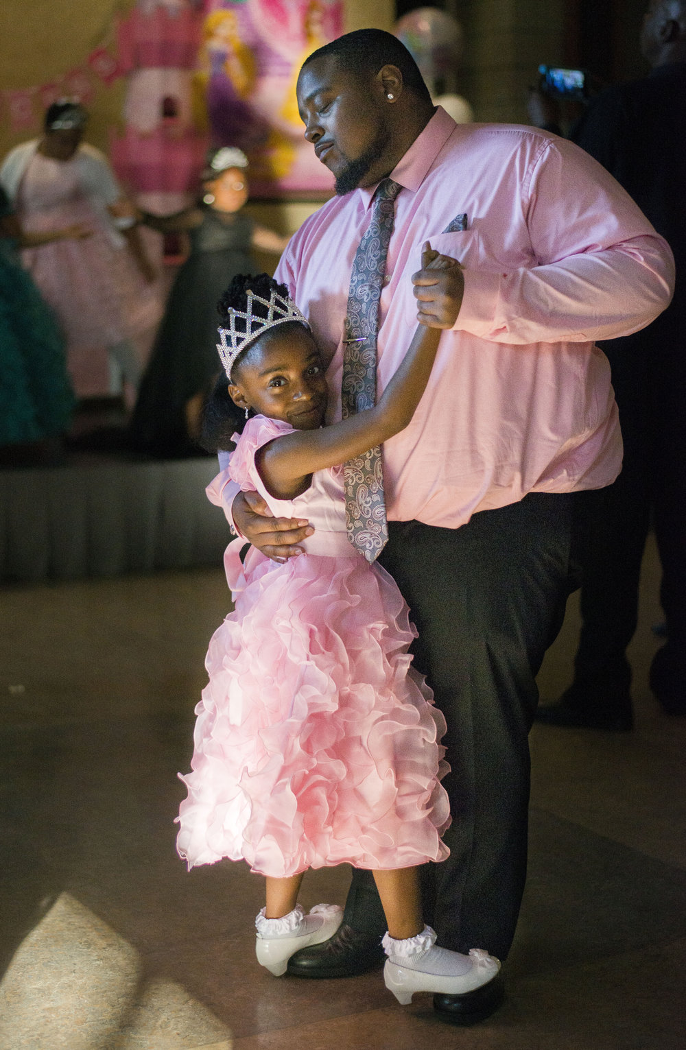Ziara Glenn, 6, slow dances with her father, Jamaar Glenn, 26, to a song at the Daddy Daughter Princess Ball on June 17, 2016, at the Fort Wayne Community Center.