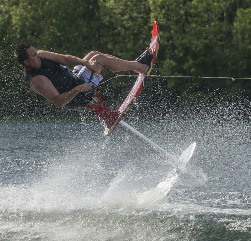 Steve Hawblitzel, 43, performs a trick while using Sky Ski during a Lake City Skiers practice at Hidden Lake. Hawblitzel was recruited to Sea World in Orlando at age and skied there for 15 years.