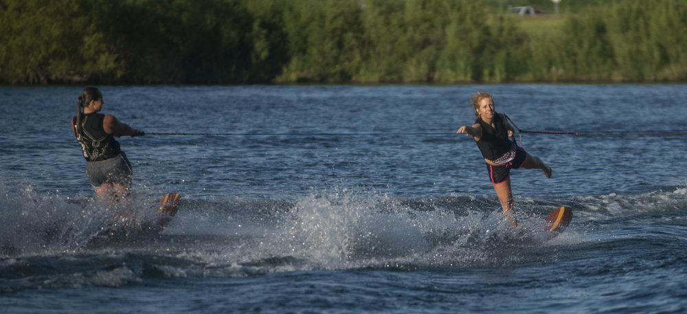 Right, Tracey Patrick, 50, practices on using a swivel ski at Hidden Lake during practice. Patrick also performs on the swivel ski, a ski that allows the skier to turn backwards while skiing.