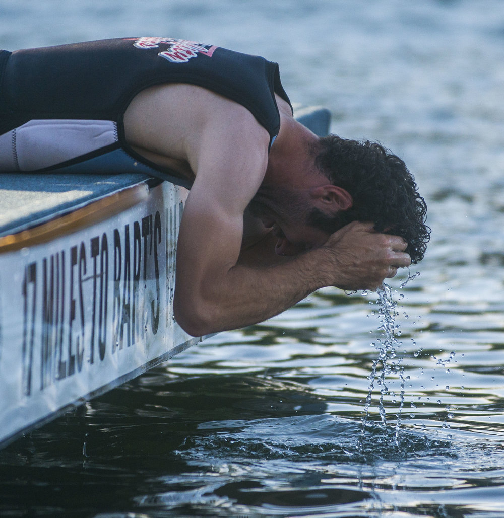 Matt Voss, 25, reaches his hands into the water and puts some water in his hair towards the end of practice on June 2 at Hidden Lake. The shows are on Sundays and Tuesdays at 2455 Hidden Lake Dr., Warsaw.