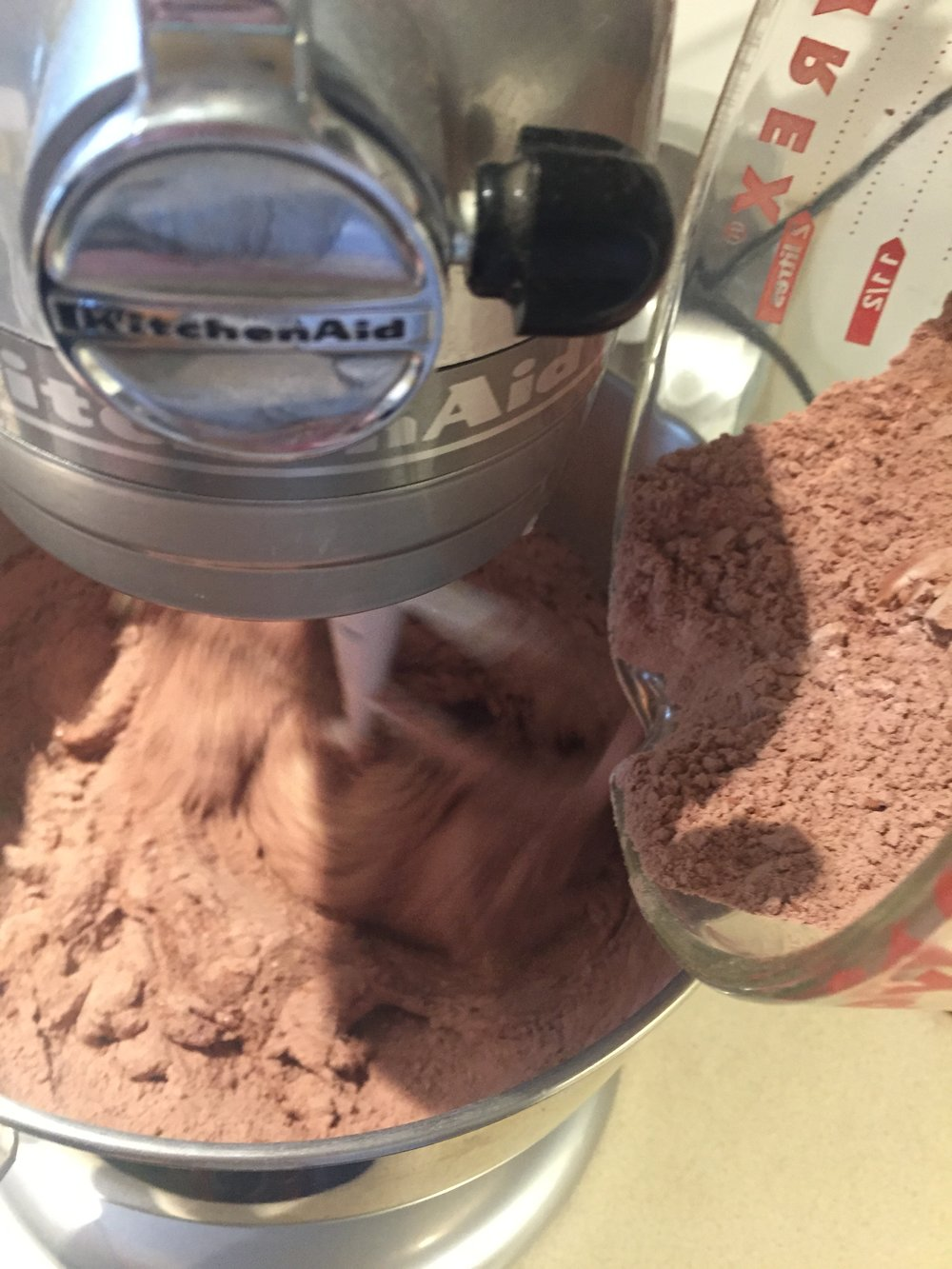 Alternate between adding the dry ingredients and the milk until fully combined.