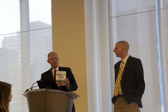 MEF Executive Director Glenn Wilke presented Kevin with a new book titled Wrigley Field: 100 Stories for 100 Years authored by Dan Campana and published by The History Press.