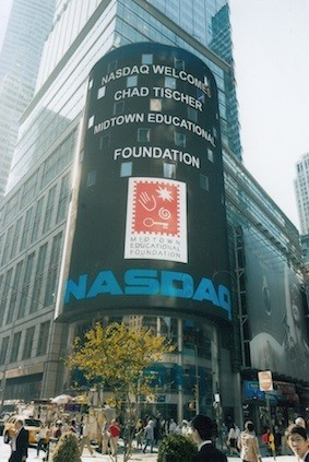 Chad Tischer, 2009-2012 Auxiliary Board Co-Chair, is recognized in Times Square