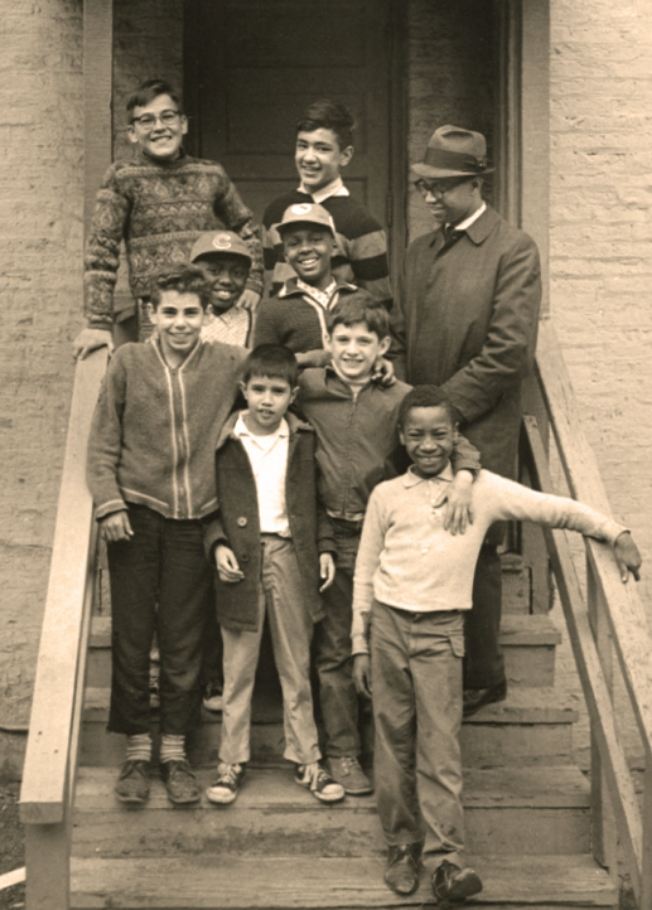 A group of original Midtown kids on the steps of 718 S. Loomis