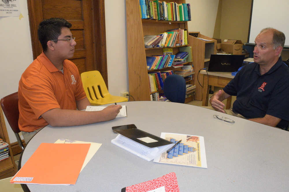 Midtown student Danny Sanchez interviews Andy Clark for a story in the Midtown Voice newspaper.