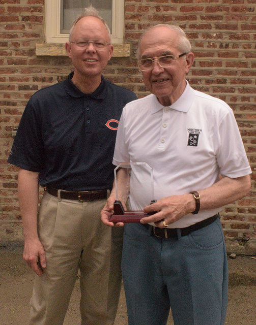 Art Thelen receives an award from Executive Director Glenn Wilke