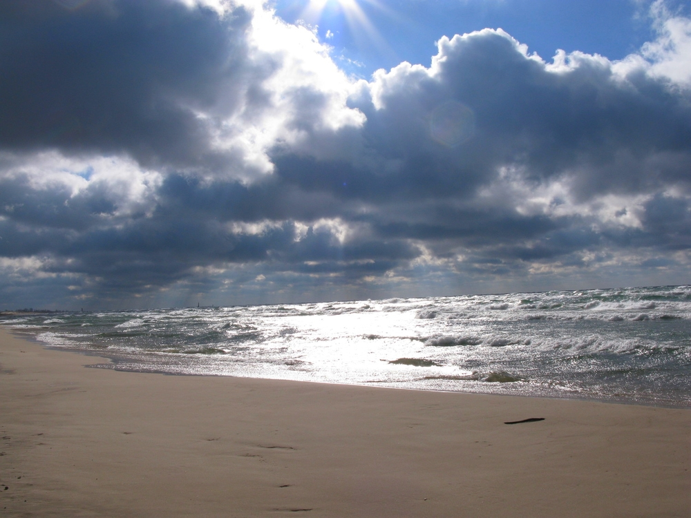 Sunlight breaking through clouds over Lake Michigan