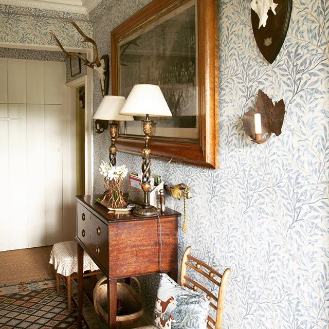 William Morris wallpaper in the hall, photograph by @huntleyhedworth for @countrylivinguk