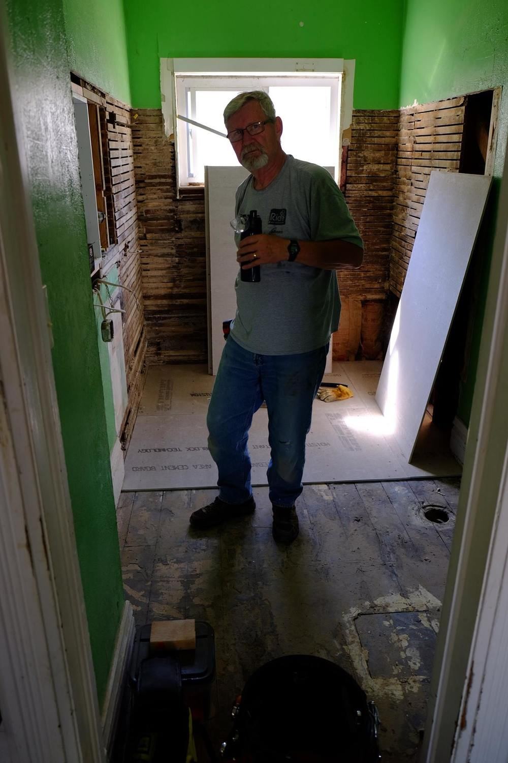 Bob rehabbing the bathroom of the Ransom street rehab.