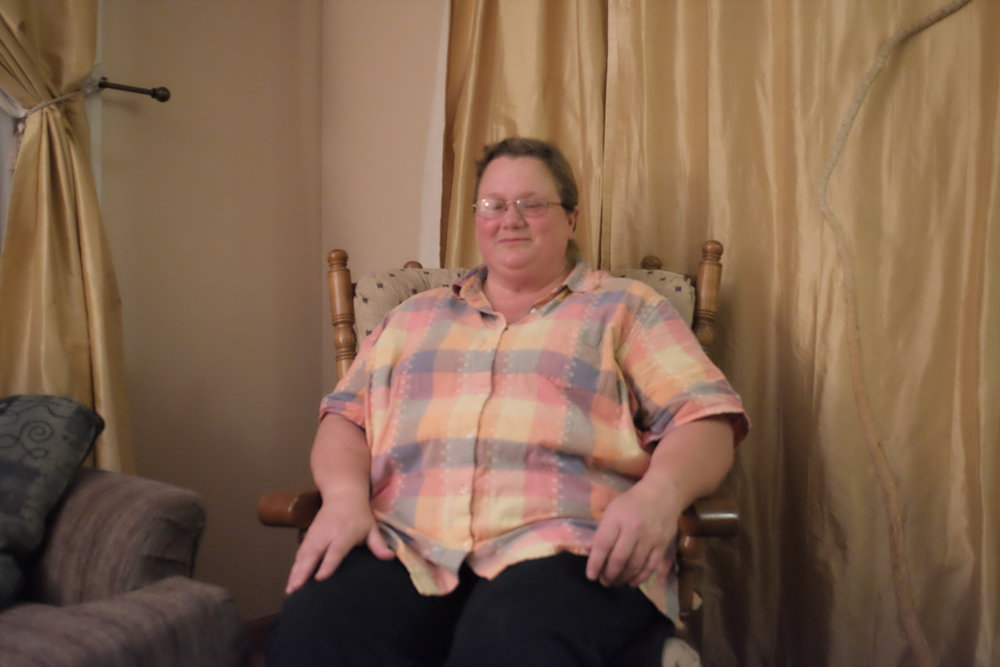 Shawn at home in her favorite chair.