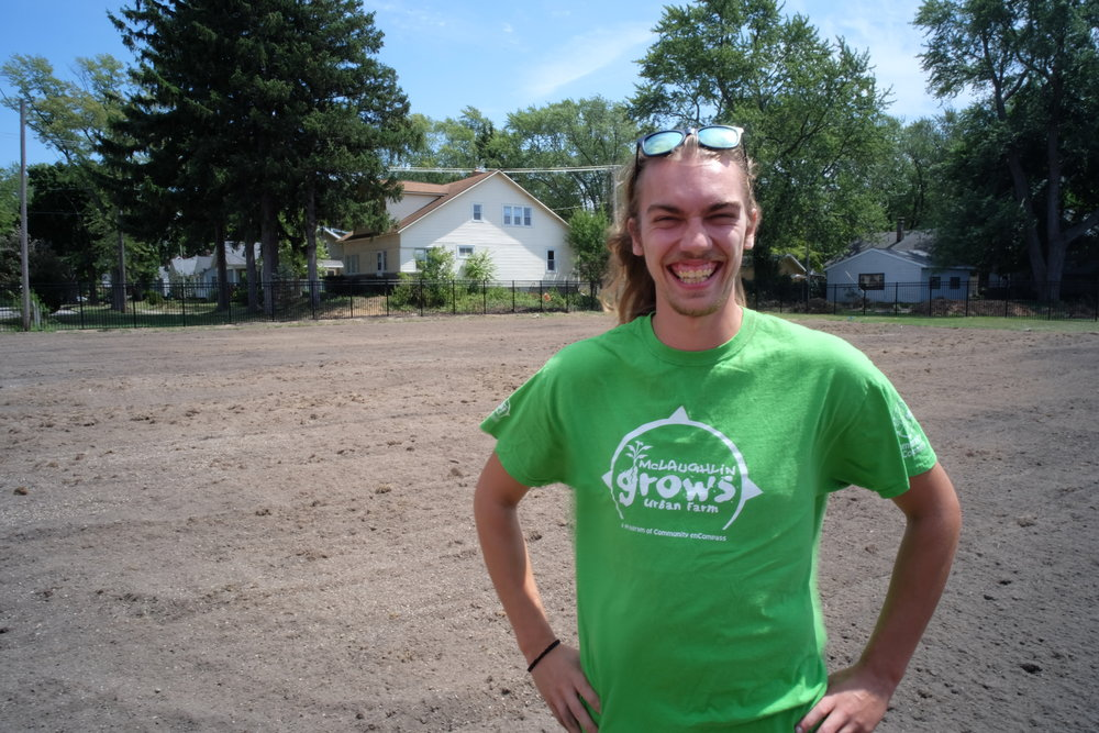"""I'm Adam Swanson. I'm an MSU Student, in my 3rd year, majoring in Sustainability and Community Development. Most of my summers growing up were spent with Community enCompass on the farm: I started as a Growing Goods student in summer school when I was in Junior High School. Then, I was a YEP in high school, leading other Junior High School kids at the Farm. And this summer I came back again to lead the farm's newest development at the old Nims School."""