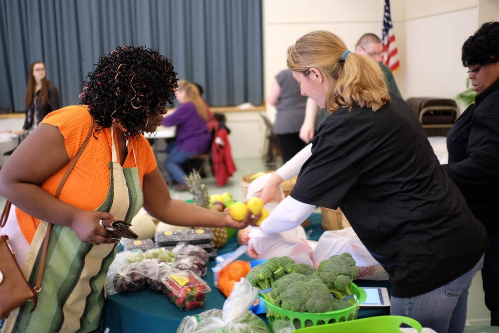 Benita buying veggies from the YMCA Veggie Van.