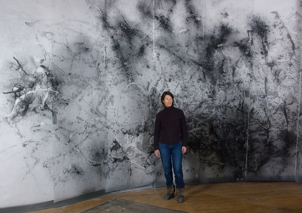 Julie Tremblay, in her studio drawing charcoal on vellum, 2015