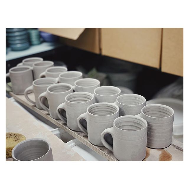 Due to the overwhelming popularity of our new mugs we've haven't had any for sale for a couple of weeks. So the guys in the studio are hard at work on a new batch. There was a big debate about handles & merits of sponges vs. chamois but thankfully that's now been resolved!