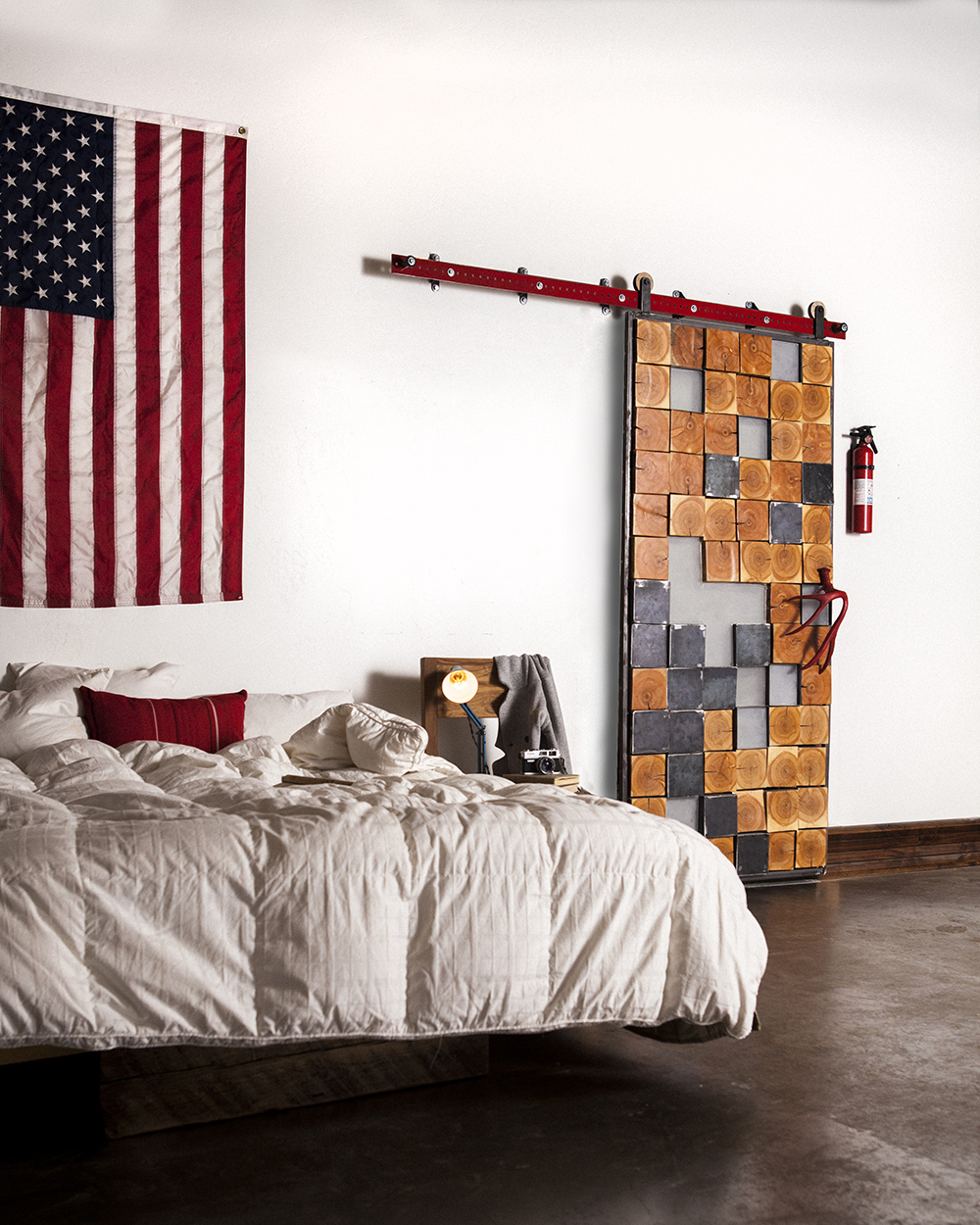 Photo via Rustic Hardware Barn door made from salvage wood with custom U.S.-made barn door slide.
