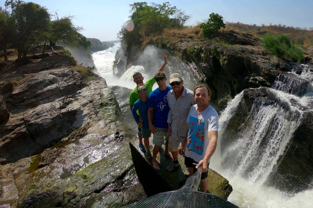 Standing at the top of Murchison Falls with the crew. Photo: Benny Marr