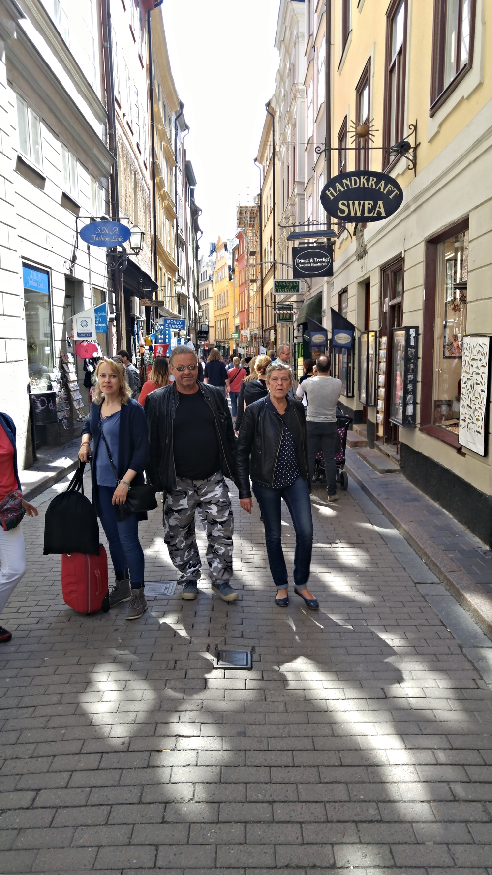 """V ästerlanggatan is located in Gamla Stan, or """"Old Town."""" Gamla Stan is located on the island just south of central Stockholm. These folks obviously love it."""