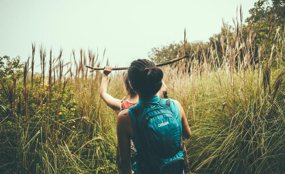 KAUAI_Awaawapuhi_Trail_hike_Paulina_Amy_tall_grass.jpg