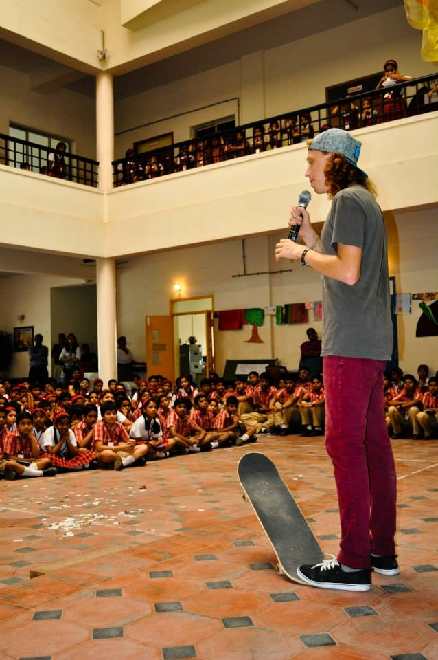 Nathaniel sharing the Gospel with students in India after a skateboard demo.