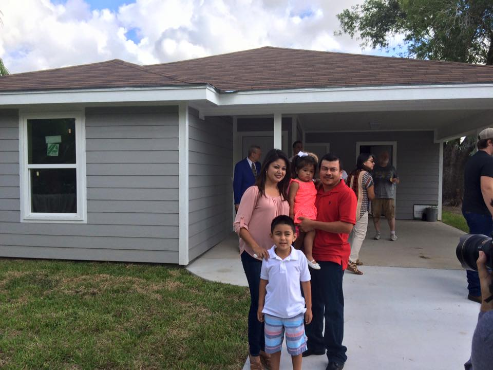 The new homeowners in front of their house in harlingen