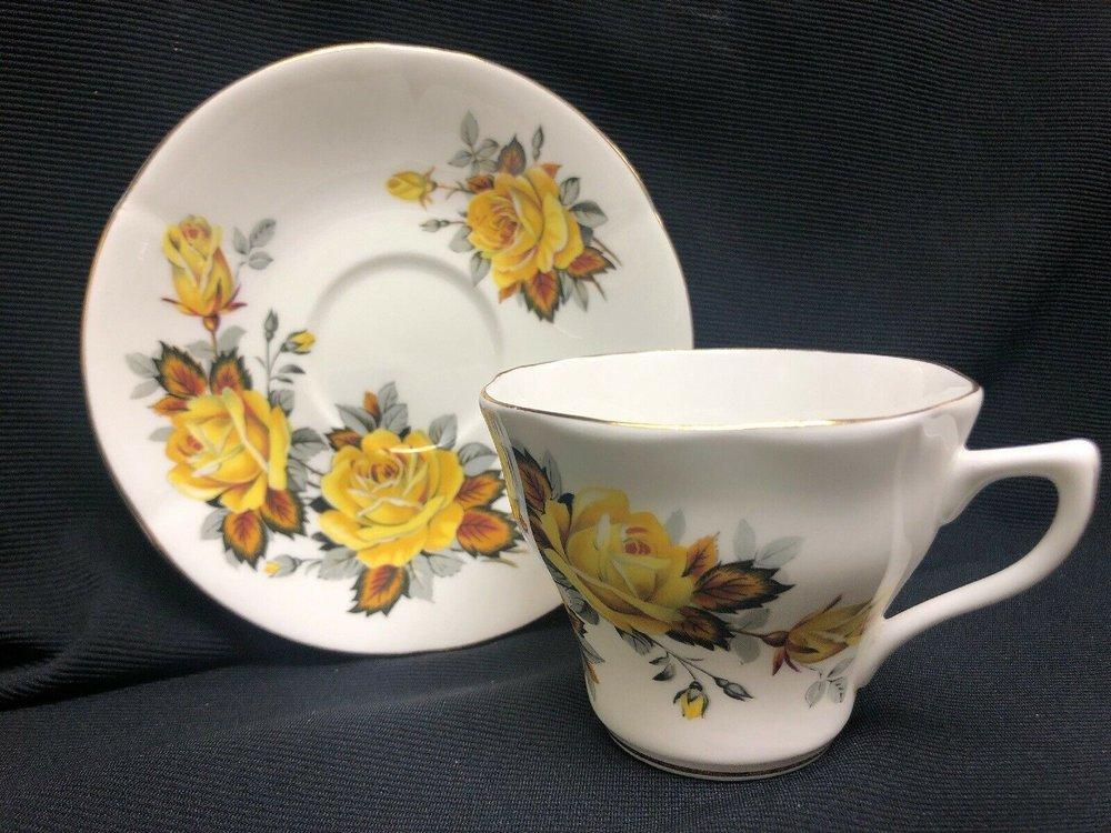 ebay teacup and saucer yellow.jpg