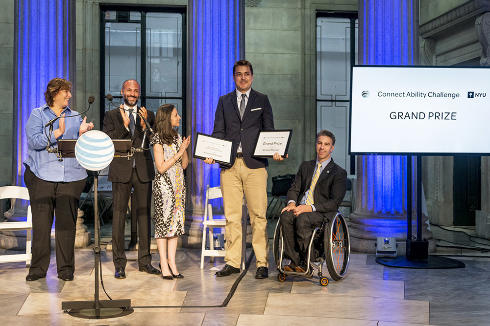Markus Pröll accepting the Grand Prize and Best Mobility Solution awards for his Connect Ability Challenge submission KinesicMouse (photo courtesy ofMarkus Pröll)