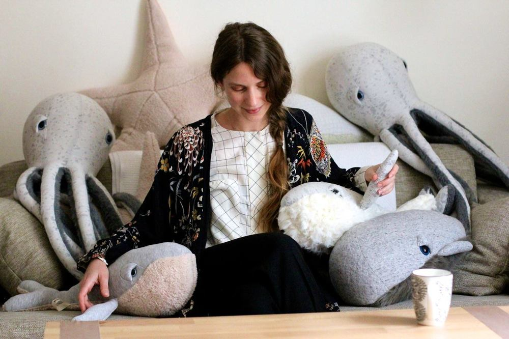 BigStuffed founder and creator, Dana Muskat, sits among her stuffed sea animals. Photo via Les Jolis Mondes