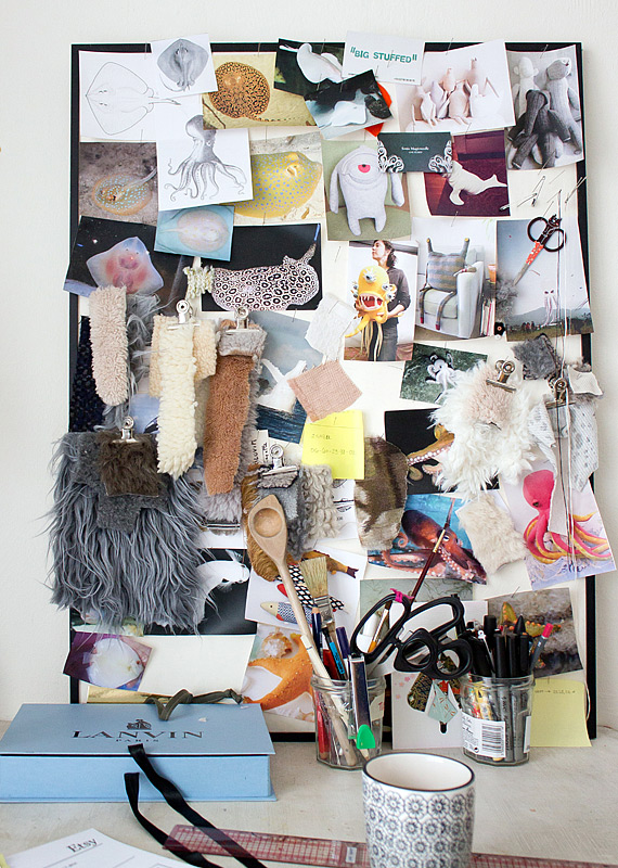 A mood board in Dana's studio covered with bits and pieces that inspire her designs.