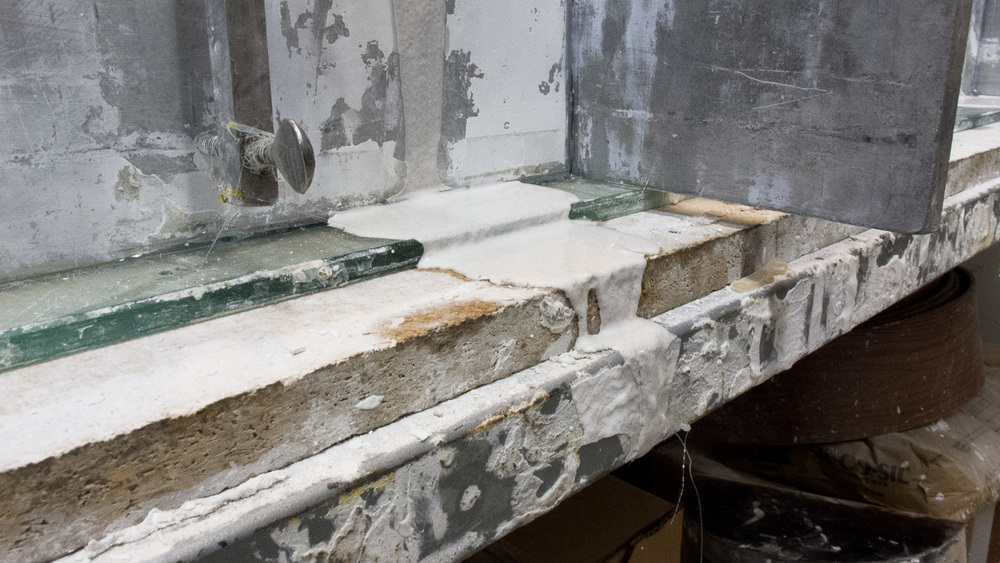 Plaster seeping down a steel mold coddle